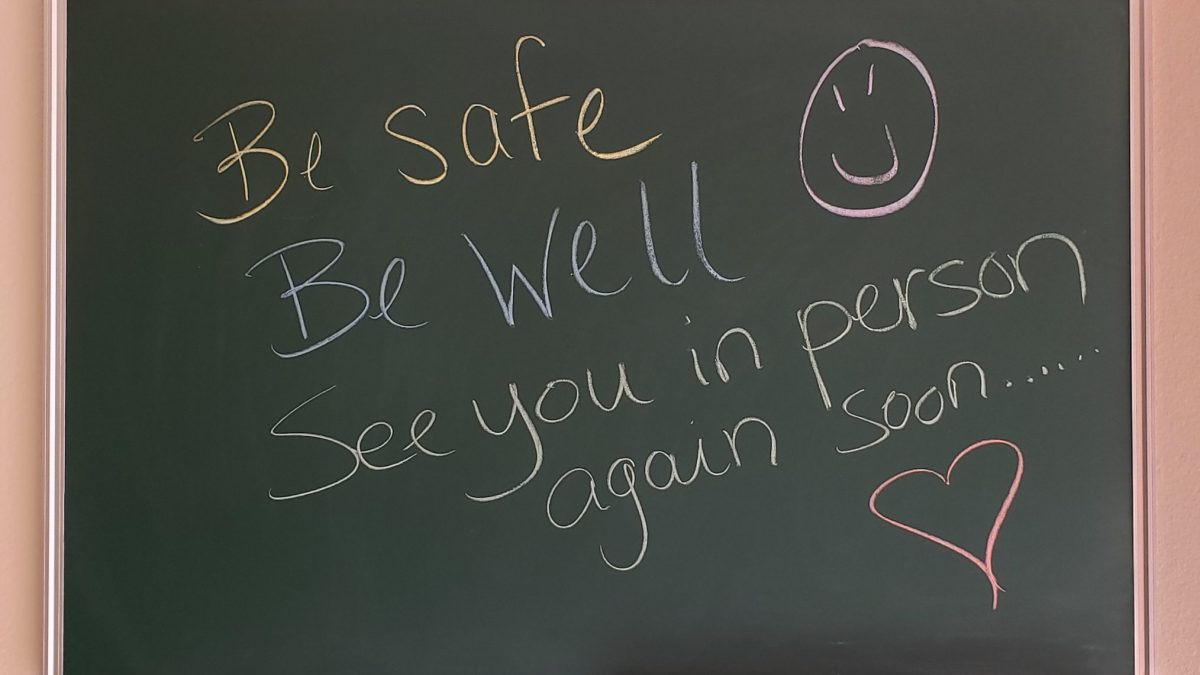 Chalk board with written greetings - Be Safe, Be Well, See you in person again soon...